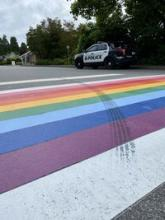 Tire marks left on rainbow crosswalk
